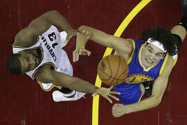 Cleveland Cavaliers center Tristan Thompson (13) against Golden State Warriors forward Anderson Varejao (18) in the first half in Game 6 of the NBA basketball Finals, Thursday, June 16, 2016, in Cleveland. (AP Photo/Ron Schwane)