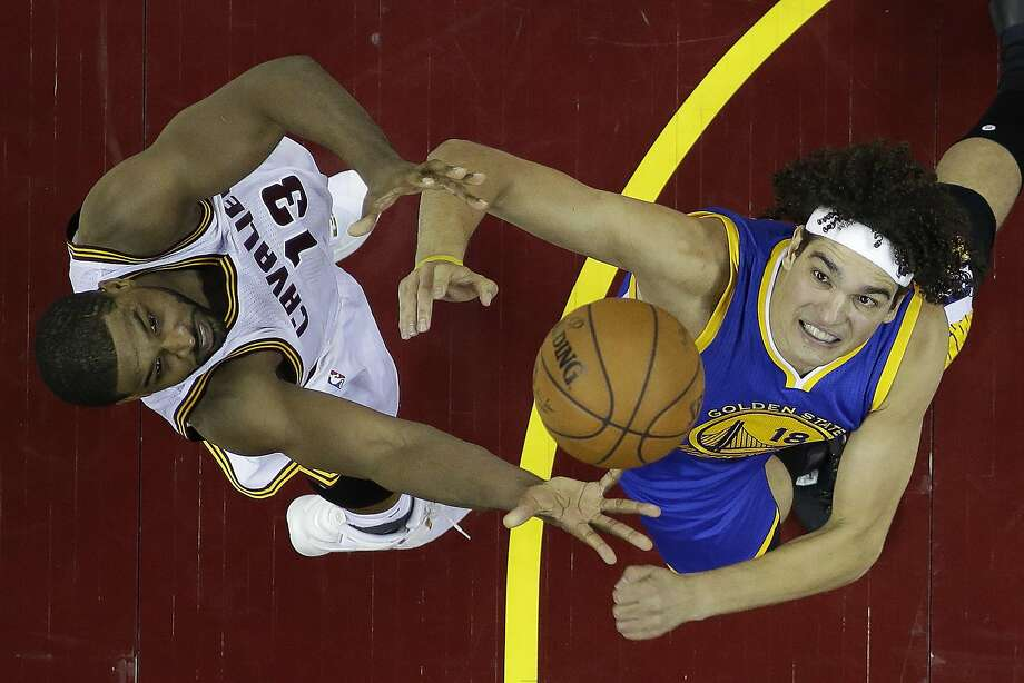 Cleveland Cavaliers center Tristan Thompson (13) against Golden State Warriors forward Anderson Varejao (18) in the first half in Game 6 of the NBA basketball Finals, Thursday, June 16, 2016, in Cleveland. (AP Photo/Ron Schwane) Photo: Ron Schwane, Associated Press