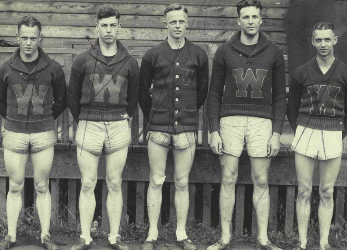 1920s: Will Carry Colors Of The WestHere are the five able athletes who will leave this morning for Chicago where on Saturday they will enter the national intercollegiate track and field championships. More than 100 schools are entered, but local track fan believe the great Washington quintet will win enough points to be heard from in the final reckoning. Left to right they are Reginald Piatt, 400-yard man; Harry Beall, half miler; Chuck Frankland, hurdled and bumper; Gus Pope, discus and shot put and Vic Hurley, sprinter and low hurdles.