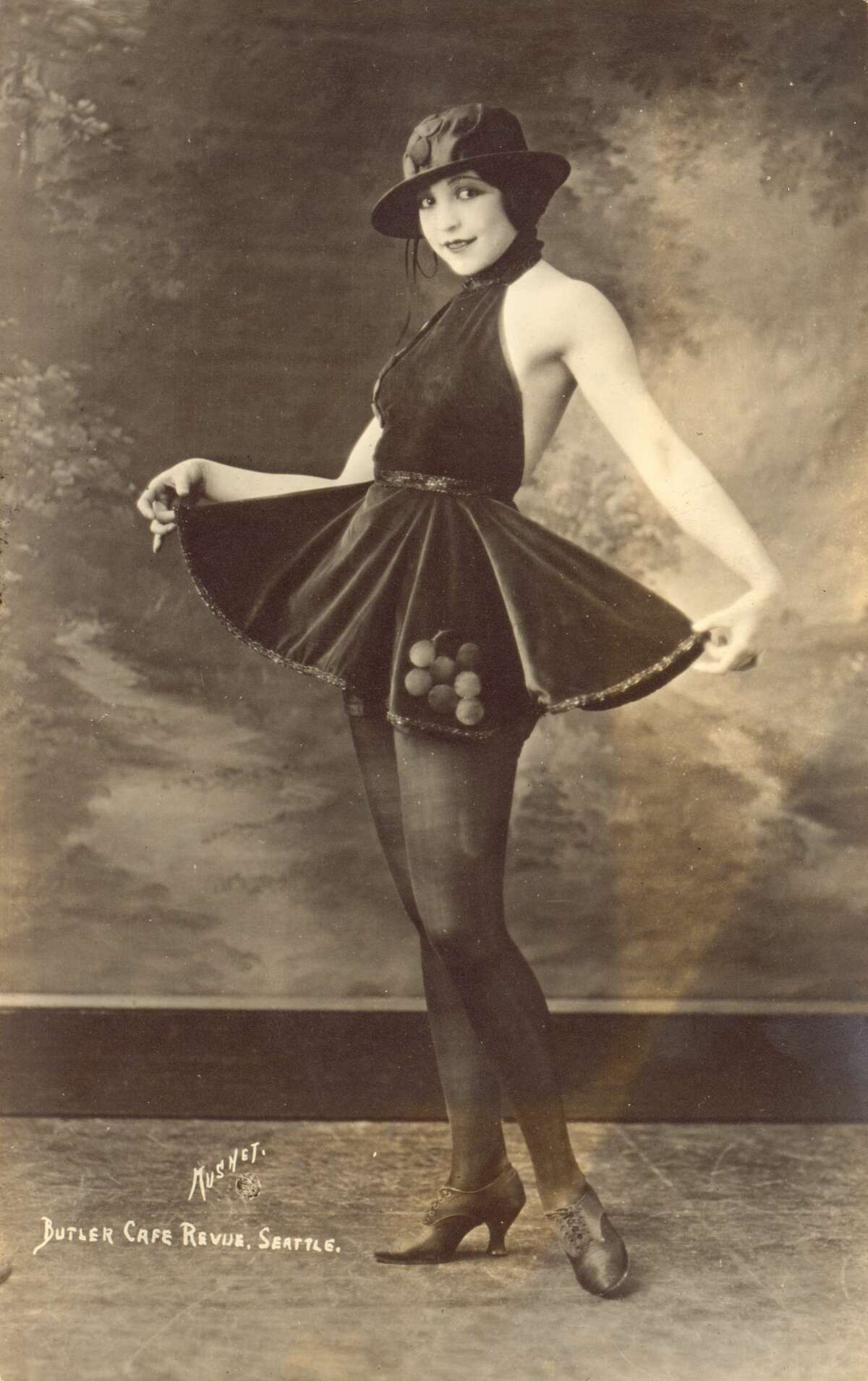 1920s: Silver print of a woman entertainer in a short skirt, from the Butler Cafe Revue, Seattle.