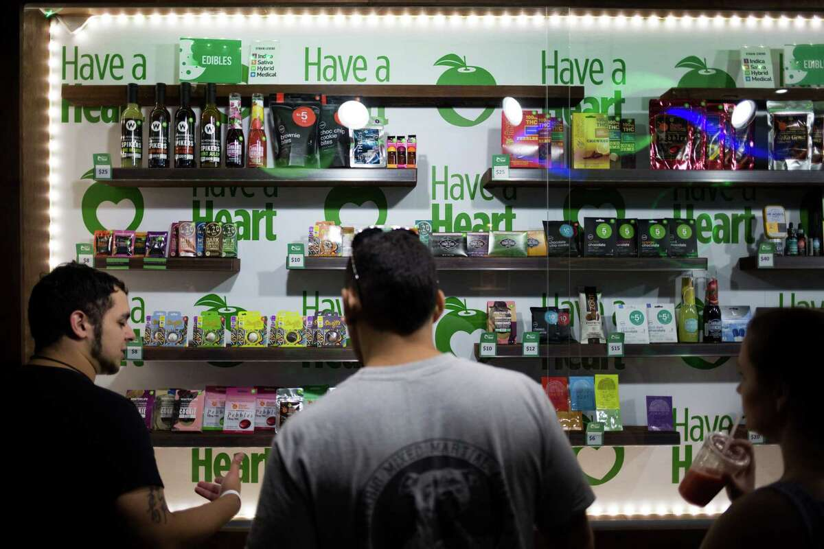 People shop for cannabis products at Have a Heart's newest store in Belltown, on Tuesday, July 12, 2016.