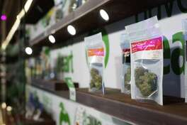 Recreational weed lines the shelves of Have a Heart's newest store in Belltown, on Tuesday, July 12, 2016.