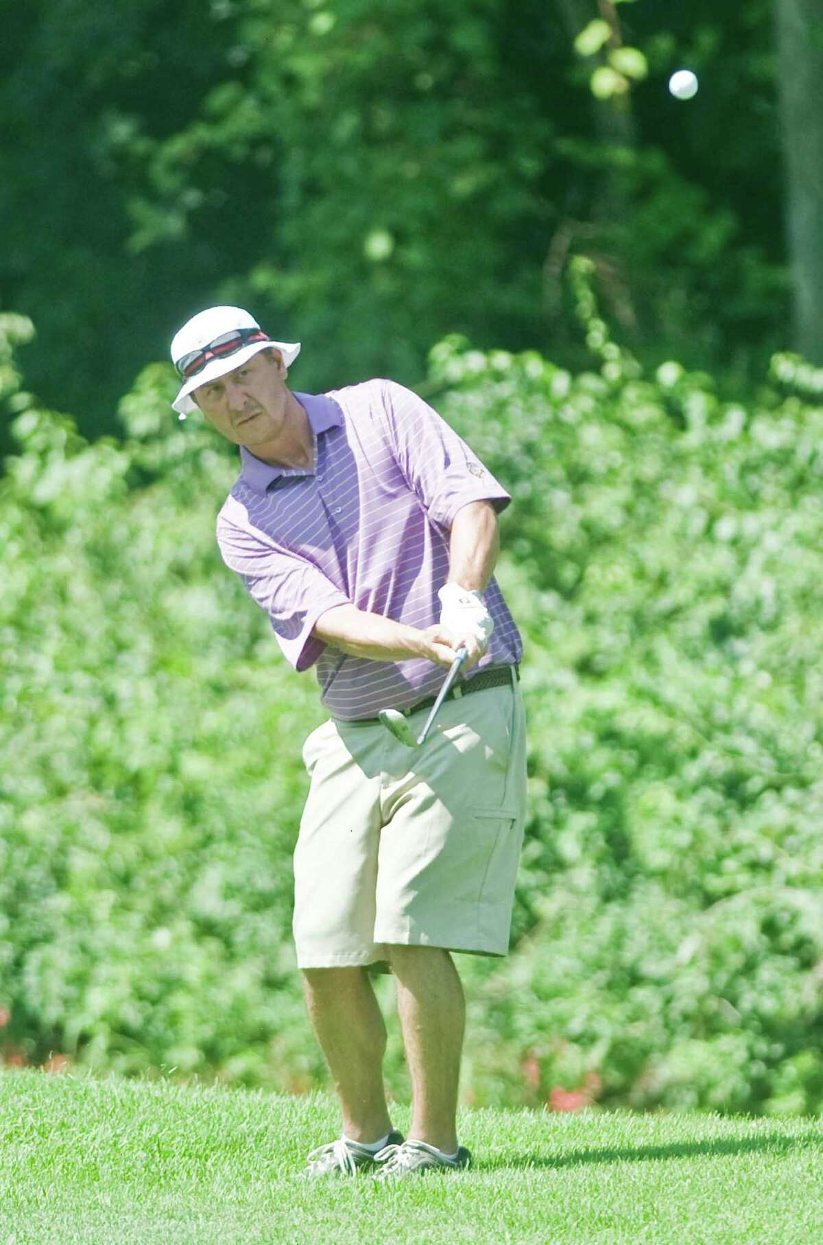 Chet Hrostek watches his wedge shot in the final round of Danbury Amateur golf tournament at Richter Park. Sunday, July 19, 2015
