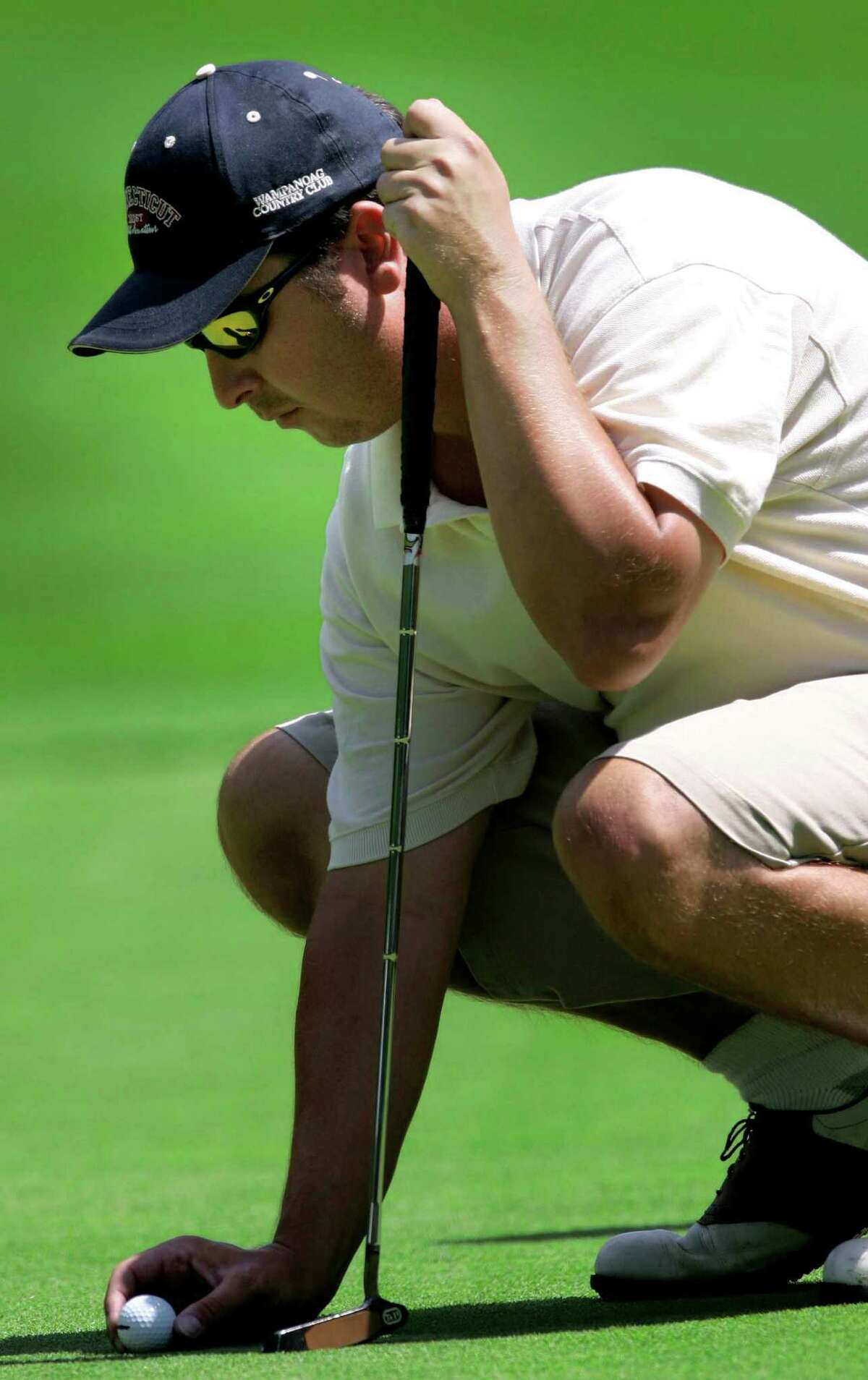 DANBURY CT. - JULY 20: Chet Hrostek places his ball on the fifth green during thechampionship round of the Danbury Amateur Tornament at Richter Park Sunday, July 20, 2003.