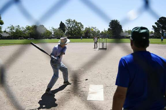 Barry Chen swings in his bi-weekly softball game on Thursday, July 14, 2016 in Alameda, California. The park that Webster plays on is home to a Pok�stop.