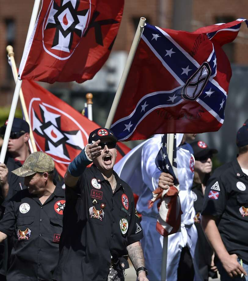 """In this Saturday, April 23, 2016 photo, Loyal White Knights Grand Dragon Will Quigg of Anaheim, Calif., center, shouts to protestors during a """"White Pride,"""" rally, in Rome, Ga. The name """"Ku Klux Klan"""" evokes horror for many, but what is the organization today? The AP is interviewing imperial wizards and grand dragons, a watchdog group and others to develop a portrait of the KKK as it exists in 2016. (AP Photo/Mike Stewart) Photo: Mike Stewart, Associated Press"""