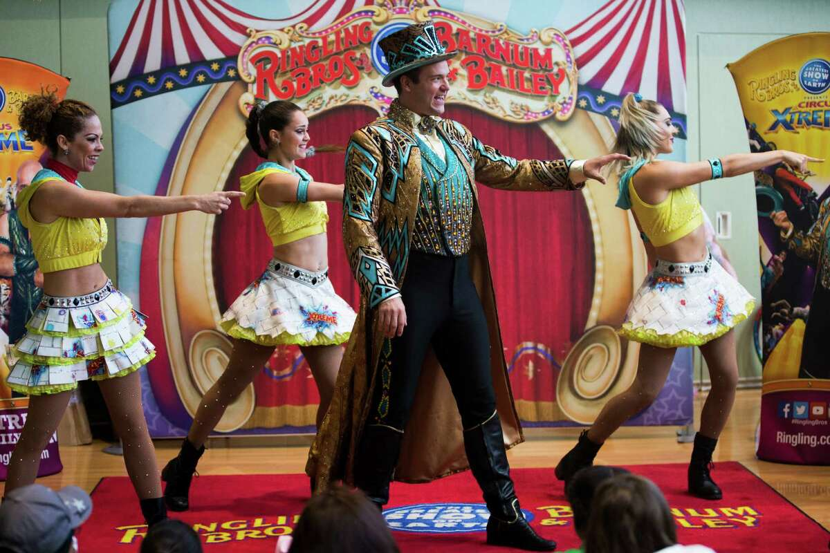 Ringling Bros. and Barnum & Bailey Circus Xtreme ringmaster David Shipman performs for children at MD Anderson Children's Cancer Hospital, Thursday, July 14, 2016, in Houston.