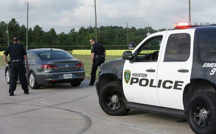 Houston Police officers demonstrate a traffic stop as they test vehicle-pursuit technology at the driving track of the Houston Police Academy in Houston.