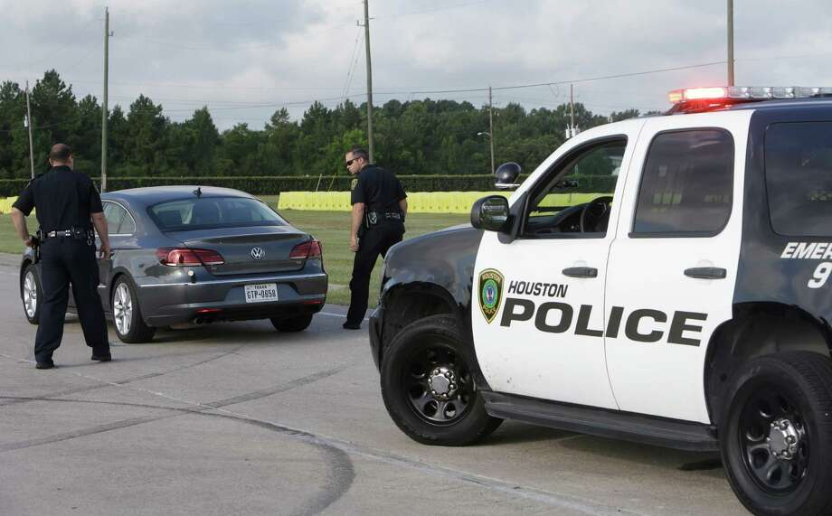 Houston Police officers demonstrate a traffic stop as they test vehicle-pursuit technology at the driving track of the Houston Police Academy in Houston. Photo: Melissa Phillip, Staff / © 2016 Houston Chronicle