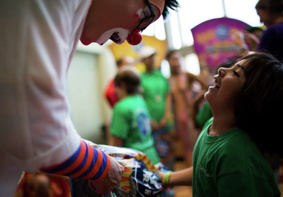 Taylor Albin boss clown at Ringling Bros. and Barnum & Bailey shares a moment with Mia while he was presenting her with gifts at MD Anderson Children's Cancer Hospital, Thursday, July 14, 2016, in Houston.