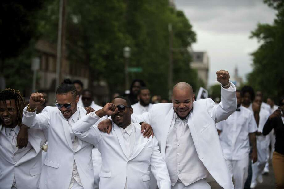 ST. PAUL, MN - JULY 14: Pallbearers lead a march down Selby Avenue after the funeral of Philando Castile at the Cathedral of St. Paul on July 14, 2016 in St. Paul, Minnesota. Castile was shot and killed on July 6, 2016 by police in Falcon Heights, Minnesota. (Photo by Stephen Maturen/Getty Images) Photo: Getty Images / 2016 Getty Images