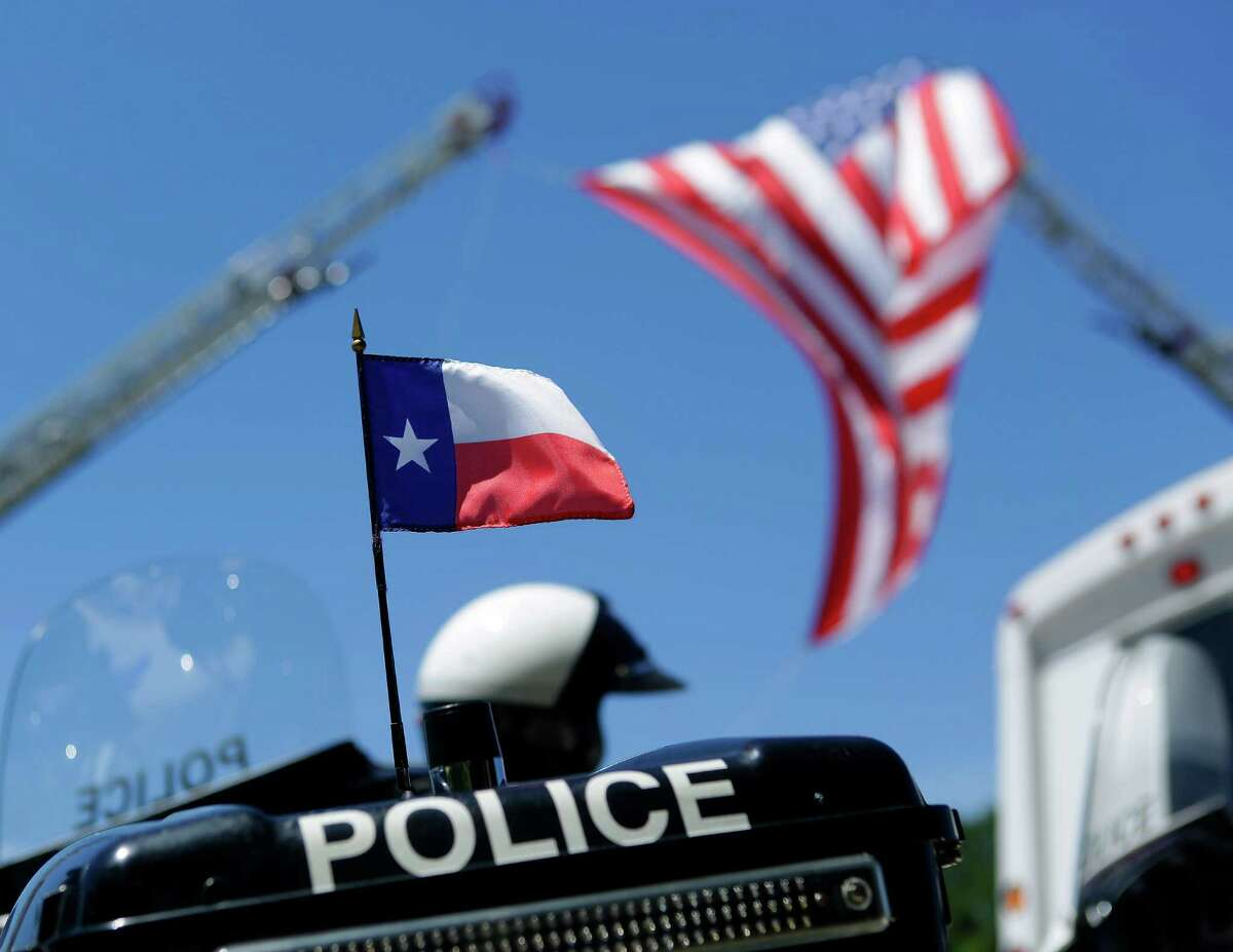 A Texas flag is on the back of a police motorcycle outside of the funeral for Dallas police SergeantMichaelSmithat Watermark Community Church, Thursday, July 14, 2016, in Dallas.