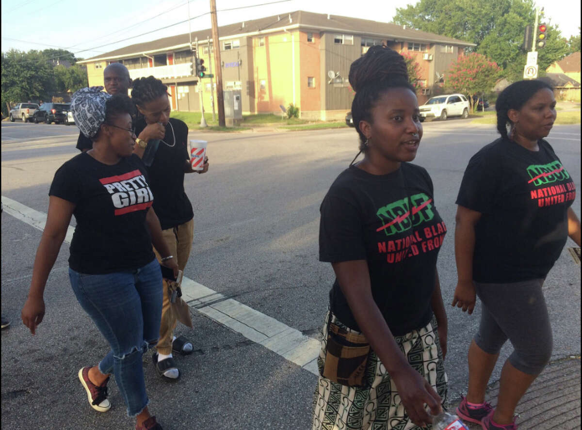 Protesters gather in the 2300 block of Southmore on Thursday.