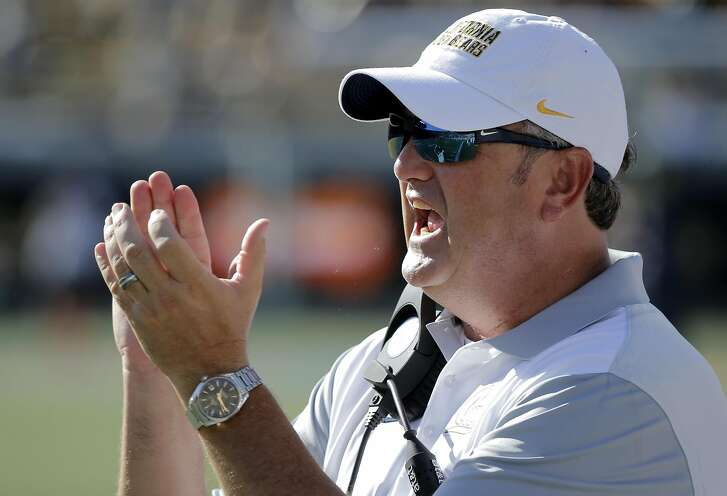 Cal head coach Sonny Dykes cheers on his defense late in the game, as the University of California Golden Bears take on the Grambling State Tigers at Memorial Stadium on Sat. September 5, 2015, in Berkeley, Calif.