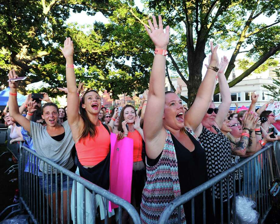 Krista MacKenzie, center right, is the first to scream for Hanson as the take the stage at Alive@Five on Thursday, July 14, 2016. MacKenzie, from Nova Scotia, arrived at Columbus Park at 5am to make sure she got a front row seat. Photo: Michael Cummo, Hearst Connecticut Media / Stamford Advocate