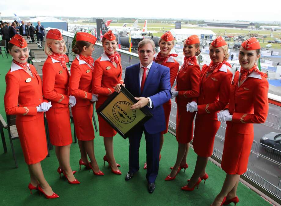 FARNBOROUGH, UNITED KINGDOM - JULY 11, 2016: Aeroflot General Director Vitaly Savelyev (C) seen after a ceremony of presenting the 2016 Skytrax World Airline Awards as part of the 2016 Farnborough International Airshow. Russia's Aeroflot has been named the Best Airline in Eastern Europe. Marina Lystseva/TASS (Photo by Marina Lystseva\TASS via Getty Images) Photo: Marina Lystseva/Marina Lystseva/TASS
