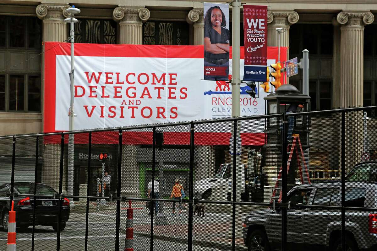Barriers divide ninth street in downtown Cleveland, Ohio, Thursday, July 14, 2016, marking the secure zone surrounding the Quicken Loans Arena, site of next week's Republican National Convention. (AP Photo/Gene J. Puskar)