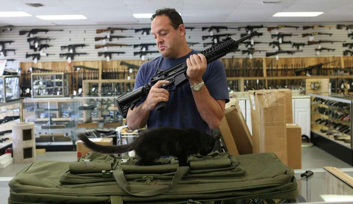 Adelbridge & Co. Firearms President Jonathan Hirsch checks out an AR-15.