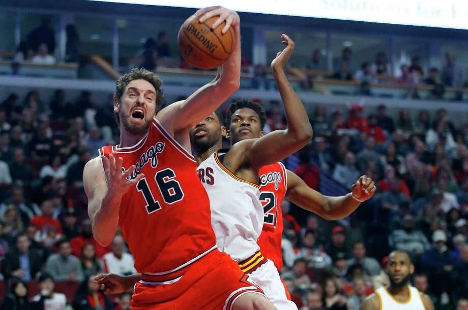 Chicago Bulls center Pau Gasol (16) grabs a rebound from Cleveland Cavaliers center Tristan Thompson (13) during the first half on April 9, 2016. The San Antonio Spurs have signed Pau Gasol, beefing up a front line that will be without Tim Duncan next season for the first time in 19 years. The Spurs did not release terms Thursday, but a person with knowledge of the situation previously told the Associated Press that he has a two-year deal worth more than $30 million. Photo: Jeff Haynes /Associated Press / FR171008 AP