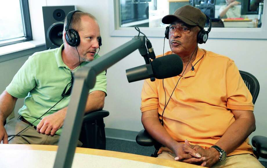 """Former baseball player Lawrence """"Dittney"""" Johnson (right) chats with Greg Garrett from the Institute of Texan Cultures as they are interviewed in the studios of Texas Public Radio on July 14, 2016. Photo: TOM REEL /SAN ANTONIO EXPRESS-NEWS / 2016 SAN ANTONIO EXPRESS-NEWS"""