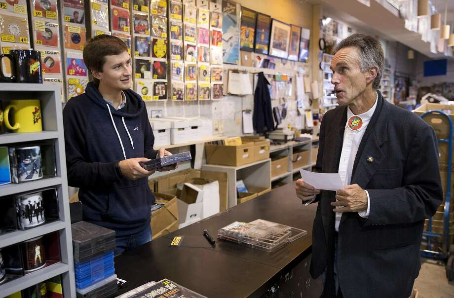 Amoeba Music employee Allen Lewites, right, gives customer Daniel Prada some music suggestions at the Haight Street location on Wednesday, July 13, 2016, in San Francisco. Lewites has been working at Amoeba for 25 years. Photo: Erin Brethauer, The Chronicle