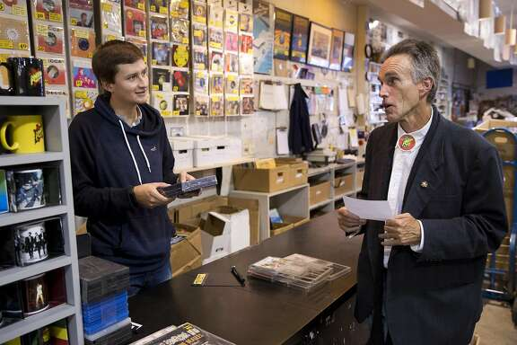 Amoeba Music employee Allen Lewites, right, gives customer Daniel Prada some music suggestions at the Haight Street location on Wednesday, July 13, 2016 in San Francisco, Calif. Lewites has been working at Amoeba for 25 years.