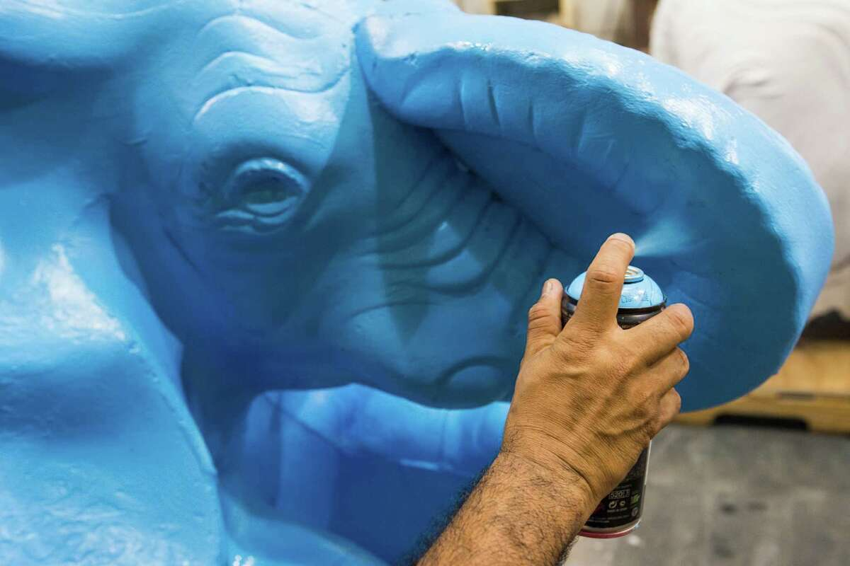 """Mario """"Gonzo 247"""" Gigueroa paints one of six cement elephants slated to be placed in the renovated Gragg Park on Thursday, July 14, 2016, in Houston. The elephants were for years were in various parks around the city and will soon be part of a """"herd"""" placed on a hill in Gragg Park, said Joe Turner, director of Houston Parks and Recreation. """"I like to recycle as best we can and we knew these would just be fun,"""" Turner said. He also added that Gonzo will add his own special touches to the elephants. The park is scheduled to reopen on September 17."""