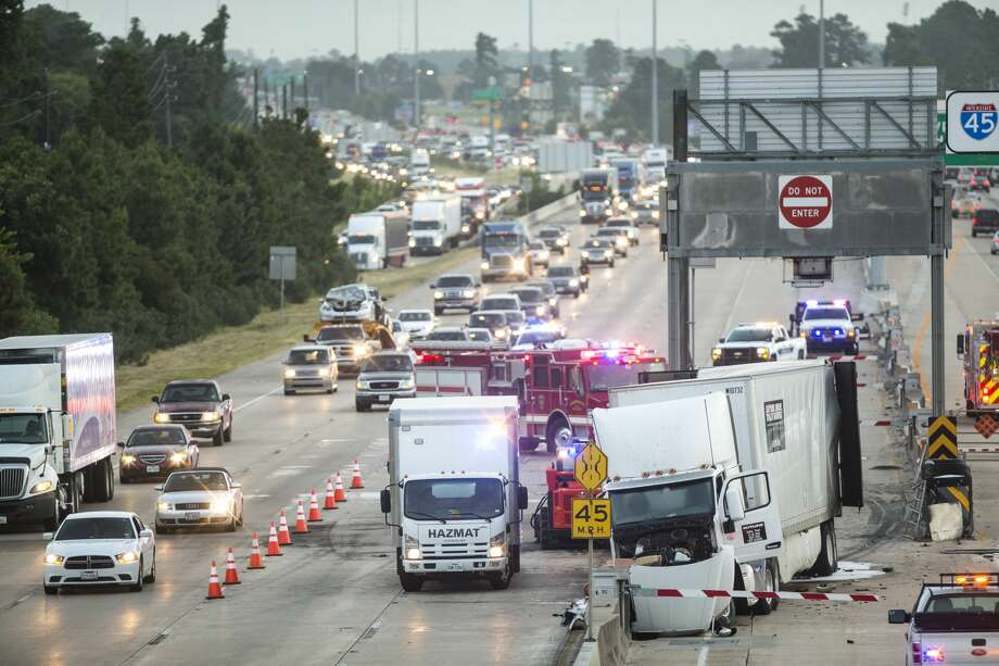 Authorities work to clean up in the aftermath of a truck fire that closed the inbound lanes of I-45, just north of FM1960, on Friday, July 15, 2016, in Houston. Photo: Brett Coomer/Houston Chronicle