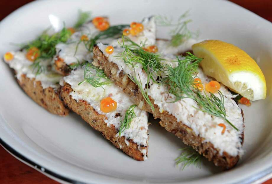 White fish crostini with trout and salmon roe, dill and pea shoots at Prairie Whale restaurant on Thursday, July 7, 2016 in Great Barrington, M.A. (Lori Van Buren / Times Union) Photo: Lori Van Buren / 20037251A