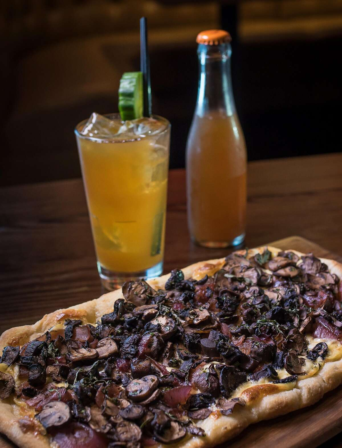 """The Mushroom Flatbread with the """"Lob No. 1"""" cocktail at Spin in San Francisco, Calif. is seen on July 14th, 2016."""