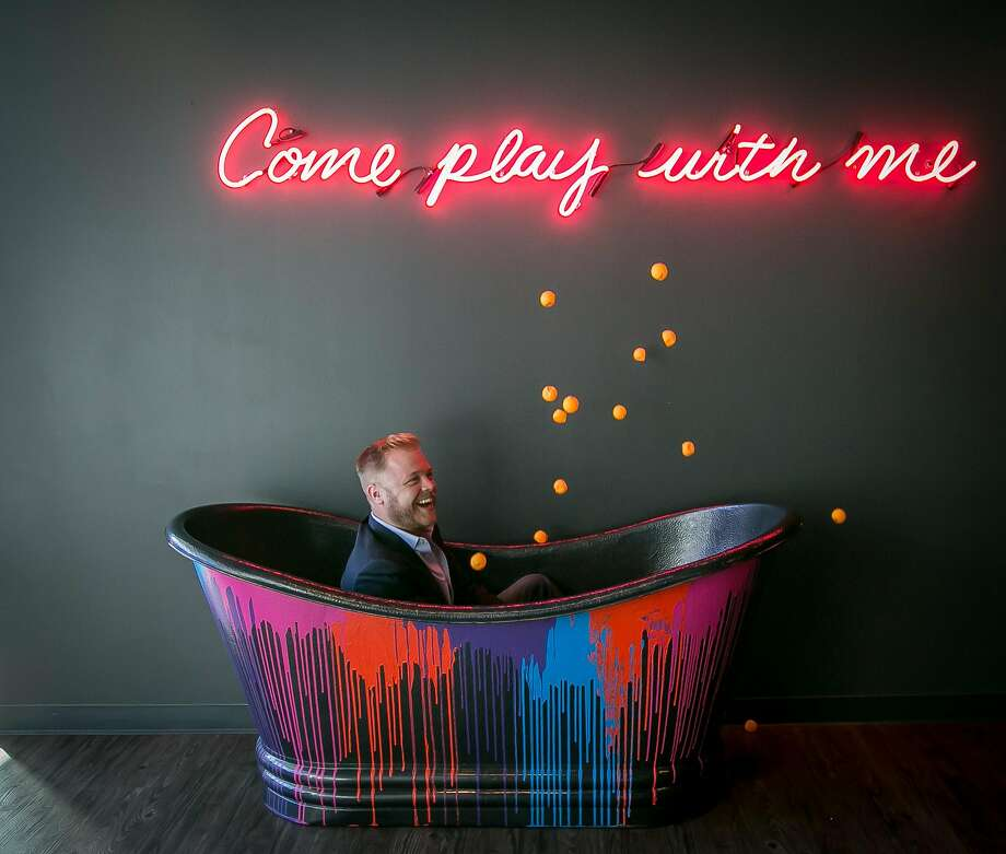 Peter Franklin plays with pingpong balls in the ball tub at Spin. Photo: John Storey, Special To The Chronicle