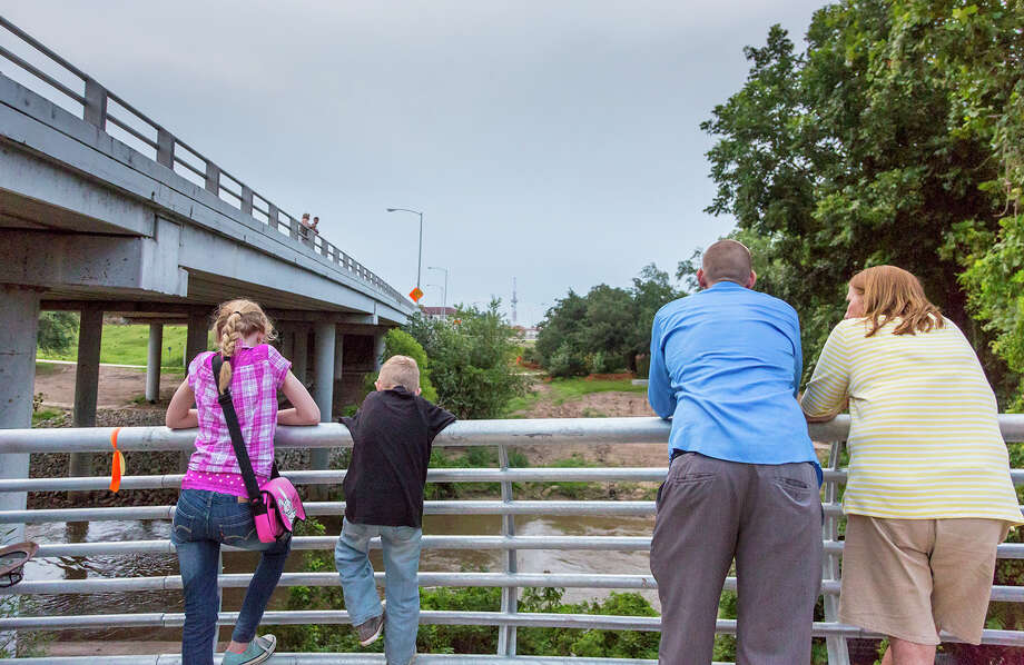 Adults and children gather at the Waugh Street Bridge to watch the nightly emergence of Mexican free-tailed bats. Photo: Kathy Adams Clark / Kathy Adams Clark/KAC Productions