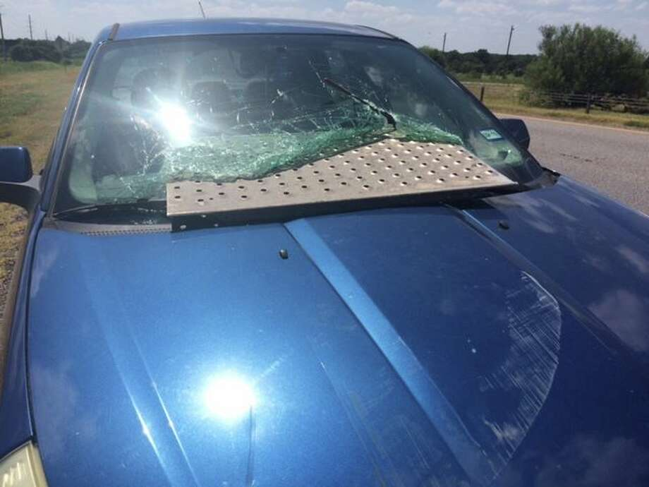 A Seguin couple walked away without injury after a sheet of metal crashed through their windshield, narrowly missing the passengers, on July 14, 2016 on Highway 123. Photo: Seguin Police Department