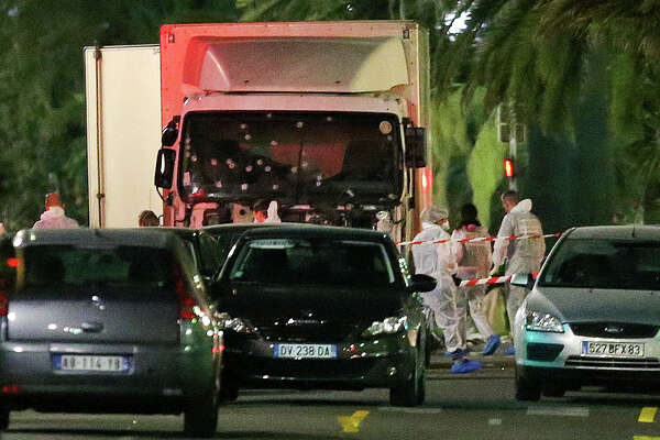 The truck that slammed into revelers late Thursday is seen near the site of an attack in the French resort city of Nice, southern France on Friday. The truck was driven onto a sidewalk for more than a mile, plowing through Bastille Day revelers who'd gathered to watch fireworks.