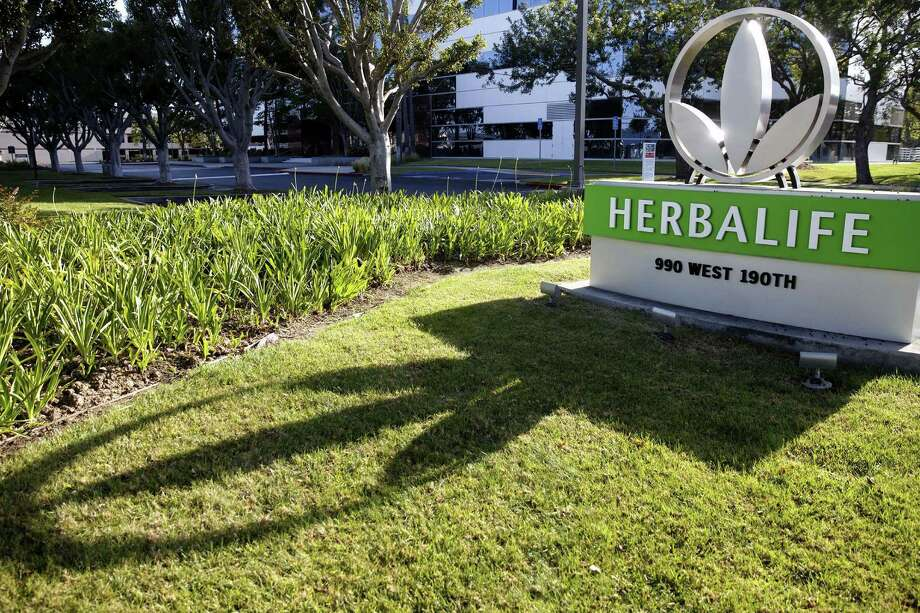 Although Herbalife was ordered to restructure its U.S. operations and pay a $200 million settlement, the multinational, nutritional supplements company avoided being classified by the U.S. as a pyramid scheme. Photo: Patrick T. Fallon /Bloomberg News / © 2016 Bloomberg Finance LP