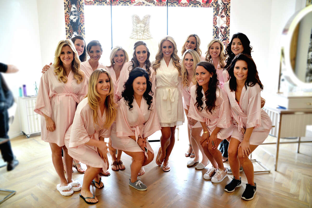 Chita Craft and her wedding party take a group photo at Maison Luisant.