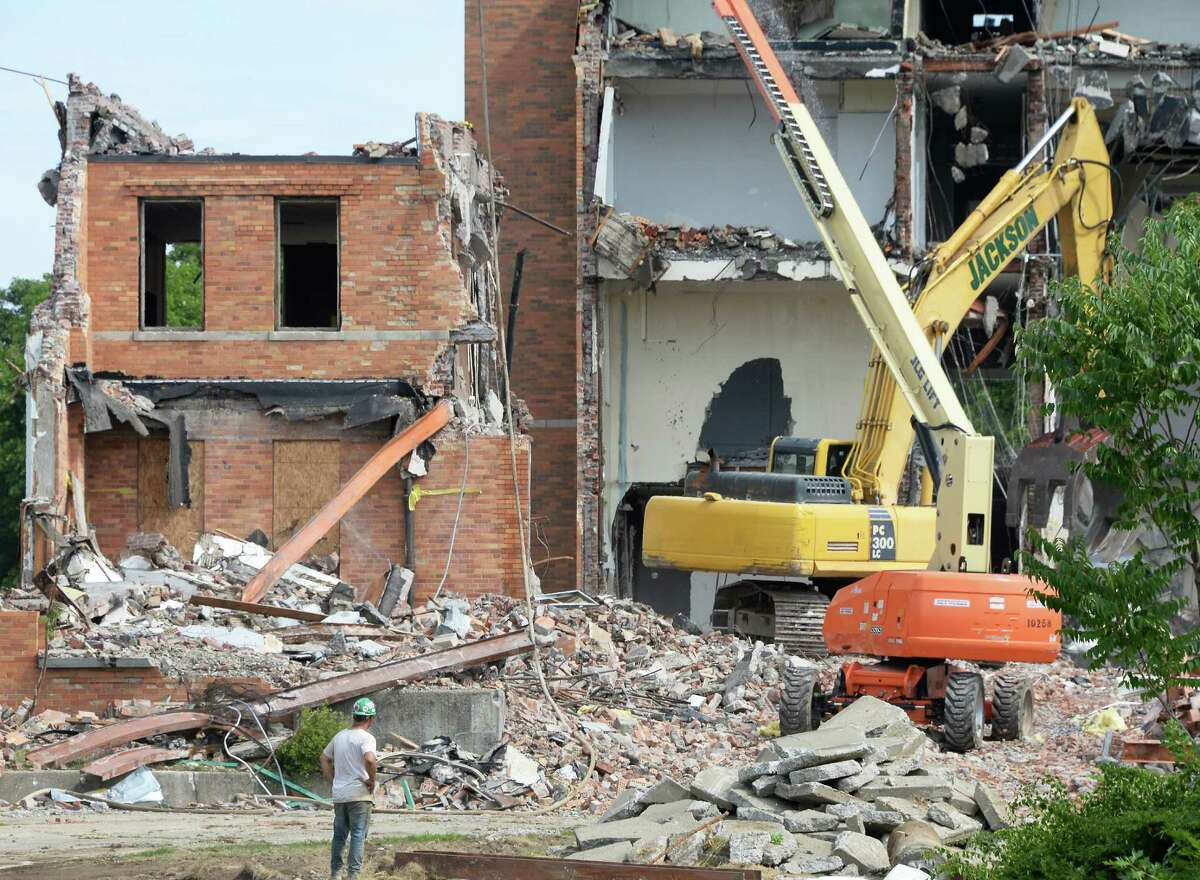 The former Hy Rosenblum Center at the HVCC campus is demolished to build privately owned and student housing at the corner of Morrison and Vandenburgh Avenues Friday July 15, 2016 in Troy, NY. (John Carl D'Annibale / Times Union)