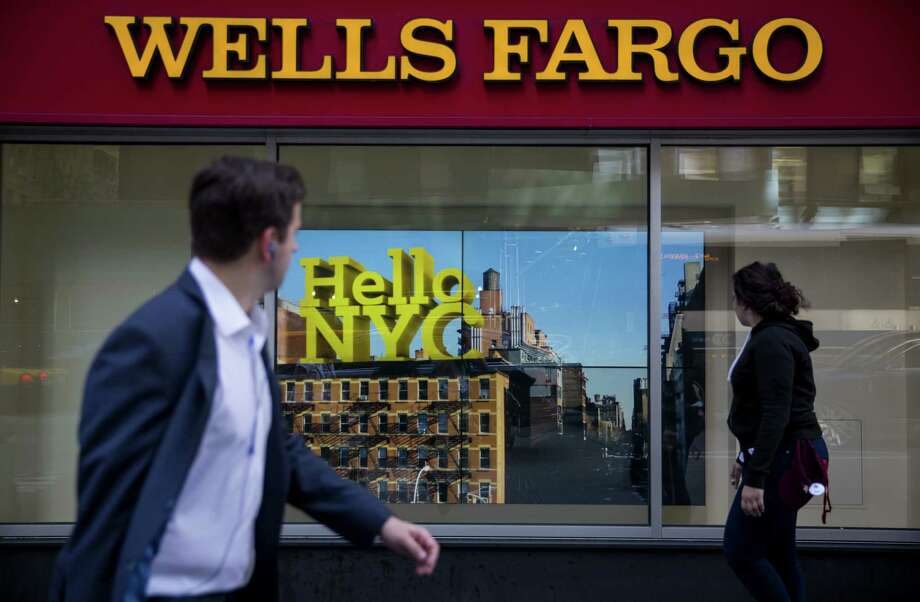 Wells Fargo continued to grow aggressively and expand its lending in all of its businesses, from industrial and commercial loans to credit cards and auto lending. Total loans were up 8 percent to $957.2 billion. Photo: Eric Thayer /Bloomberg News / © 2016 Bloomberg Finance LP