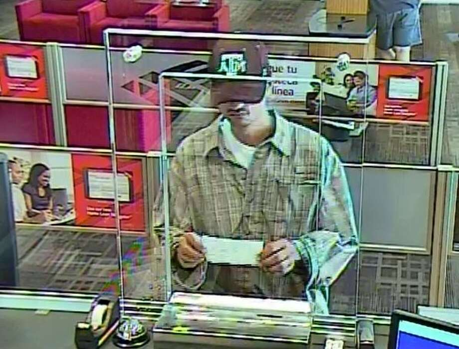 man wears texas a m cap during bank robbery in katy area