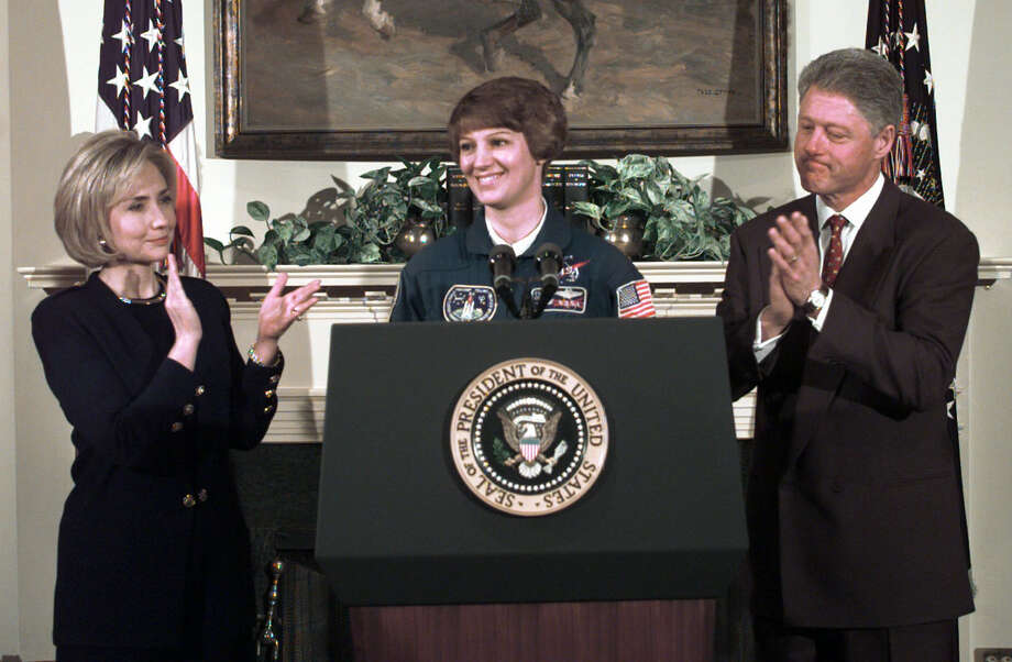President Clinton and first lady Hillary Rodham Clinton, left, applaud the United States' first woman to lead a mission into outer space, Eileen Collins, center, at a White House ceremony, Thursday, March 5, 1998. Collins, a 41-year-old U.S. Air Force lieutenant colonel, has participated in two previous space shuttle missions. (AP Photo/Susan Walsh)  HOUCHRON CAPTION (03/06/1998): President Clinton and first lady Hillary Rodham Clinton applaud Eileen Collins, who will become the first woman to command a U.S. space mission, at a ceremony in the White House Thursday. Photo: SUSAN WALSH, STF / AP / AP