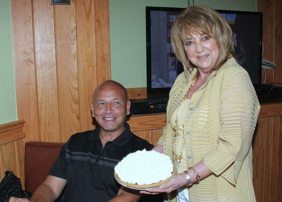Linda DeWese, owner of Tip Top Cafe, holds a chocolate icebox pie in front of Ed Garza, a former mayor of San Antonio, who claims the pie is his favorite dessert at the restaurant. Photo: Courtesy Photo /Charlie Elizalde /Event Photographics