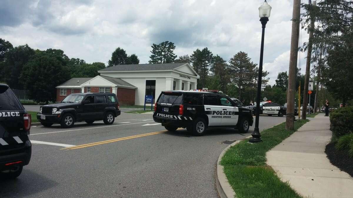 Saratoga police mass near the entrance to Saratoga Hospital on Friday. (Wendy Liberatore / Times Union)