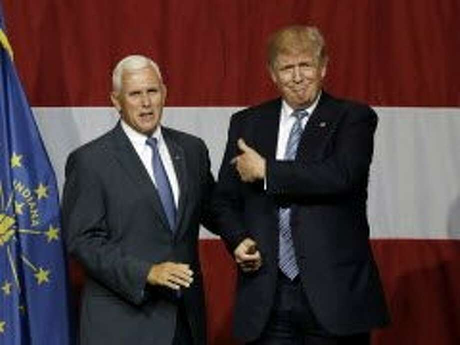 Indiana Gov. Mike Pence joins Republican presidential candidate Donald Trump at a rally in Westfield, Ind., on July 12. Photo: Michael Conroy, Associated Press