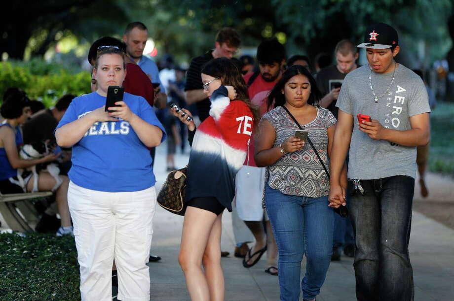 Pokemon Go players throng Discovery Green on Wednesday. Photo: Karen Warren, Houston Chronicle / © 2016 Houston Chronicle