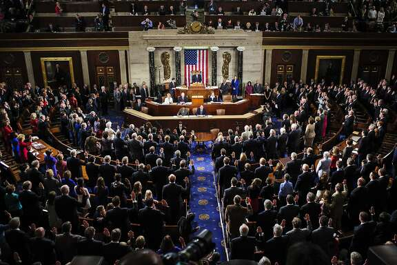 Members of the U.S. House of Representatives are sworn in at the U.S. Capitol in Washington, D.C., U.S., on Thursday, Jan. 3, 2013. The 113th Congress convenes today in Washington where new members will try to meld their diverse backgrounds in a legislature containing a record seven openly gay lawmakers, an unprecedented 20 women in the Senate and the first all-female state delegation, from New Hampshire. Photographer: Pete Marovich/Bloomberg