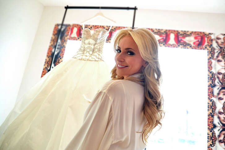 Chita Craft poses in front of her Ines Di Santo wedding gown.
