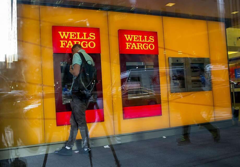 A man uses a Wells Fargo ATM in New York in July. The Consumers Union is advising Wells customers to proactively check for unauthorized accounts. Photo: Eric Thayer, Bloomberg