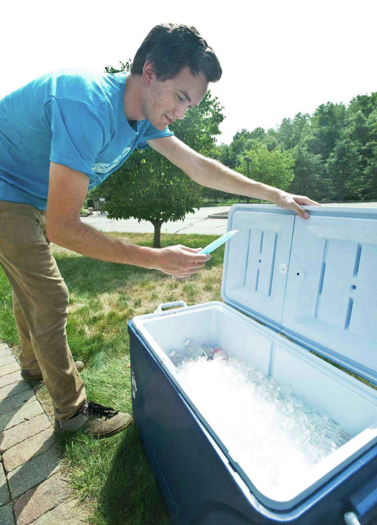 Tim Holt, Associate Youth Pastor at Walnut Hill Community Church in Bethel, put out coolers with waters and popsicles at two Pokemon Go stations on the church property for people playing the new hit game. Thursday, July 14, 2016