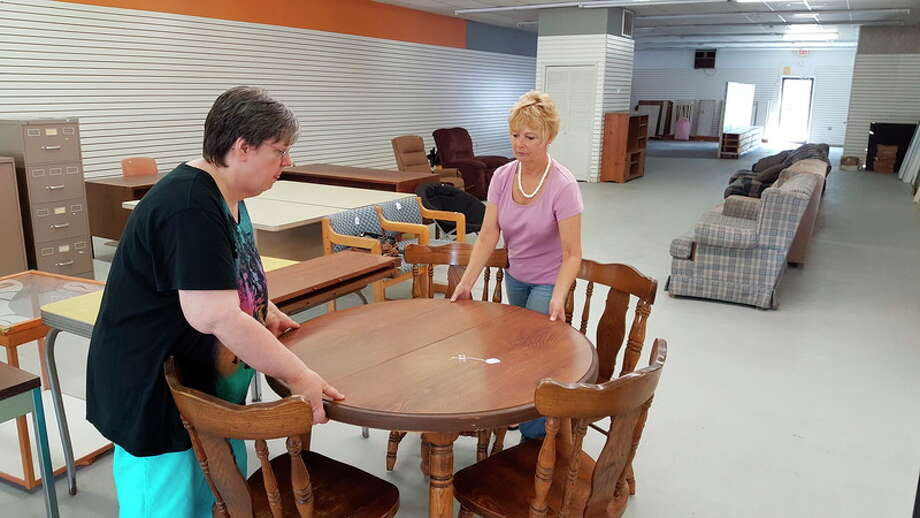 Tereasa Nims   for the Daily News Gladwin County Habitat for Humanity ReStore Manager Ruth Wright, left, and board treasurer Jovita Olsen move items for the opening day of the store, located at 117 W. Brown in Beaverton. The store opens today and is open Wednesday through Saturday.