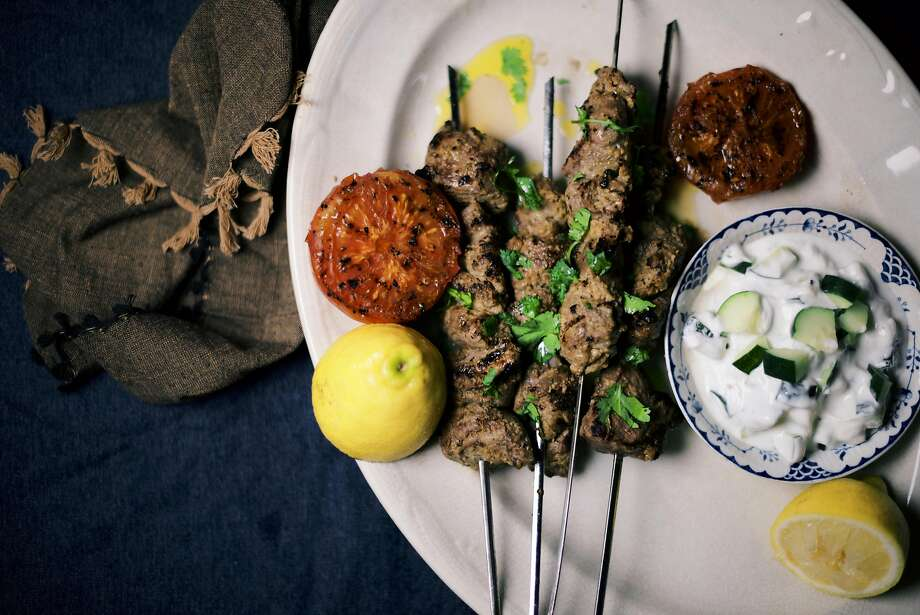 Spiced lamb kebabs and cucumber raita. Photo: Nik Sharma